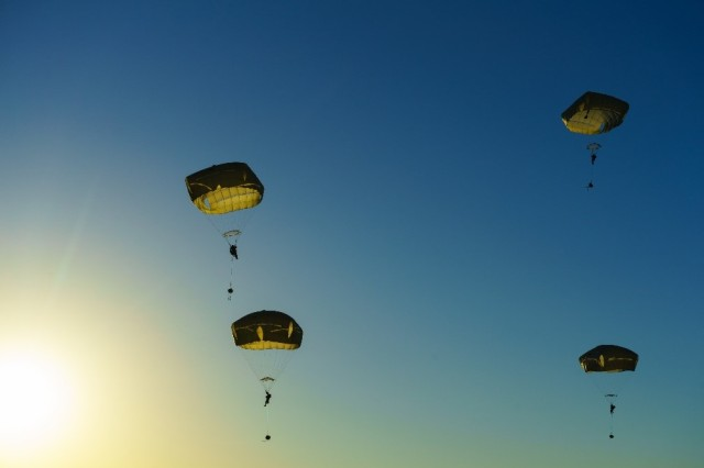 The end state Expeditionary Signal Battalion-Enhanced (ESB-E) capability package will enable the ESBs to support commanders and paratroopers en route in an aircraft, small team-sized units in initial entry operations and scale-up to support mature operations as supporting forces continue to grow on the ground. In the photo U.S. Army paratroopers with the 3rd Brigade Combat Team, 82nd Airborne Division, prepare to land after jumping from a U.S. Air Force C-17 Globemaster III as part of Swift Response 18 at a training area near Rukla, Lithuania, June 9, 2018.
