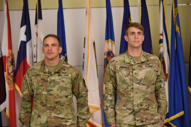 SSG Daniel Tumey and SGT Jeffrey Carter, winners of the USAMRDC 2019 Best Medic Competition, during the event's closing ceremony at Fort Detrick on Thursday August 29, 2019.
