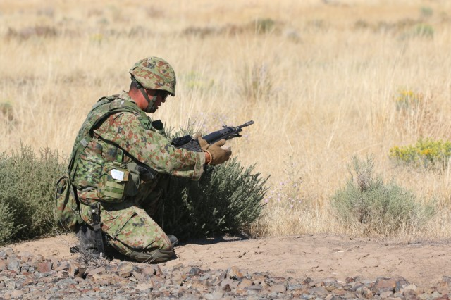 A soldier of the Japan Ground Self-defense Force clears a weapon jam during a live fire exercise during Rising Thunder 19 at the Yakima Training Center in Yakima, Washington, Sept.1, 2019. Rising Thunder 2019 is an annual exercise joining the U.S. Army and the JGSDF and is part of Pacific Pathways 19-3. Rising Thunder 2019 is also a United States Army Pacific-sponsored capstone event featuring U.S. Army units from the 7th Infantry Division and the Illinois Army National Guard's 33rd Infantry Brigade Combat Team and the 108th Sustainment Brigade. The exercise includes company/platoon unilateral and bilateral training events in two phase, culminating with a live-fire exercise. (U.S. Army Reserve Photo by Sgt. Rigo Cisneros)