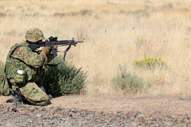 A soldier from the Japan Ground Self-Defense Force opens fire on his target in a live fire exercise during Rising Thunder, Sep. 1, at the Yakima Training Center in Yakima, Washington. Rising Thunder 2019 is an annual exercise joining the U.S. Army and the JGSDF and is part of Pacific Pathways 19-3. Rising Thunder 2019 is also a United States Army Pacific-sponsored capstone event featuring U.S. Army units from the 7th Infantry Division and the Illinois Army National Guard's 33rd Infantry Brigade Combat Team and the 108th Sustainment Brigade. The exercise includes company/platoon unilateral and bilateral training events in two phase, culminating with a live-fire exercise. (U.S. Army Reserve Photo by Sgt. Rigo Cisneros)