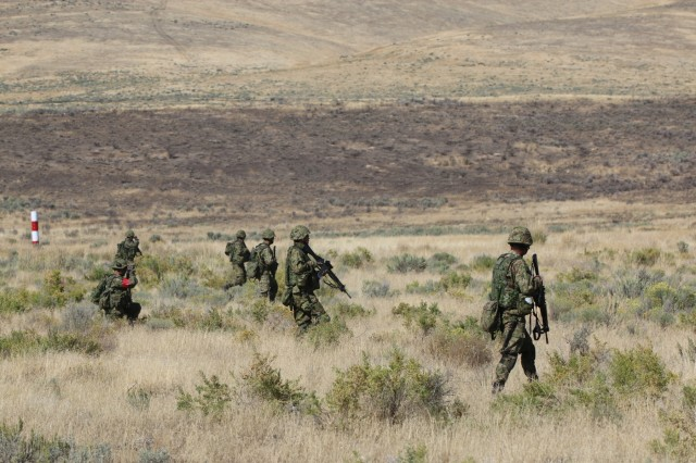 Soldiers of the Japan Ground Self-Defense Force participate in live fire exercise during Rising Thunder, Sep. 1, at the Yakima Training Center in Yakima, Washington. Rising Thunder 2019 is an annual exercise joining the U.S. Army and the JGSDF and is part of Pacific Pathways 19-3. Rising Thunder 2019 is also a United States Army Pacific-sponsored capstone event featuring U.S. Army units from the 7th Infantry Division and the Illinois Army National Guard's 33rd Infantry Brigade Combat Team and the 108th Sustainment Brigade. The exercise includes company/platoon unilateral and bilateral training events in two phase, culminating with a live-fire exercise. (U.S. Army Reserve Photo by Sgt. Rigo Cisneros)