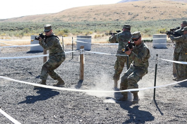 Infantrymen from D Co, 2nd Battalion, 130th Infantry Regiment, Illinois Army National Guard, rehearse room clearance drills as part of Rising Thunder 19 at the Yakima Training Center in Yakima, Washington, Sept. 1, 2019. Rising Thunder 2019 is an annual exercise joining the U.S. Army and the Japan Ground Self Defense Force (JGSDF) and is part of Pacific Pathways 19-3. Rising Thunder 2019 is also a United States Army Pacific-sponsored capstone event featuring U.S. Army units from the 7th Infantry Division and the Illinois Army National Guard's 33rd Infantry Brigade Combat Team and 108th Sustainment Brigade. The exercise includes company/platoon unilateral and bilateral training events in two phases, culminating with a bilateral live-fire exercise. (U.S. Army Reserve Photo by Sgt. Camacho Roberts)