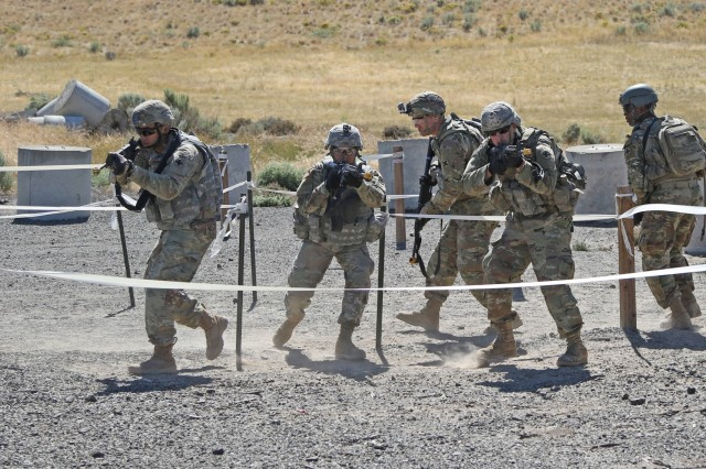 Soldiers from the 33rd Infantry Brigade Combat Team, Illinois Army National Guard, practice room-clearance drills during Rising Thunder 19 at the Yakima Training Center in Yakima, Washington, Sept. 1, 2019. Rising Thunder 2019 is an annual exercise joining the U.S. Army and the Japan Ground Self Defense Force (JGSDF) and is part of Pacific Pathways 19-3. Rising Thunder 2019 is also a United States Army Pacific-sponsored capstone event featuring U.S. Army units from the 7th Infantry Division and the Illinois Army National Guard's 33rd Infantry Brigade Combat Team and 108th Sustainment Brigade. The exercise includes company/platoon unilateral and bilateral training events in two phases, culminating with a bilateral live-fire exercise. (U.S. Army Reserve Photo by Sgt. Camacho Roberts)