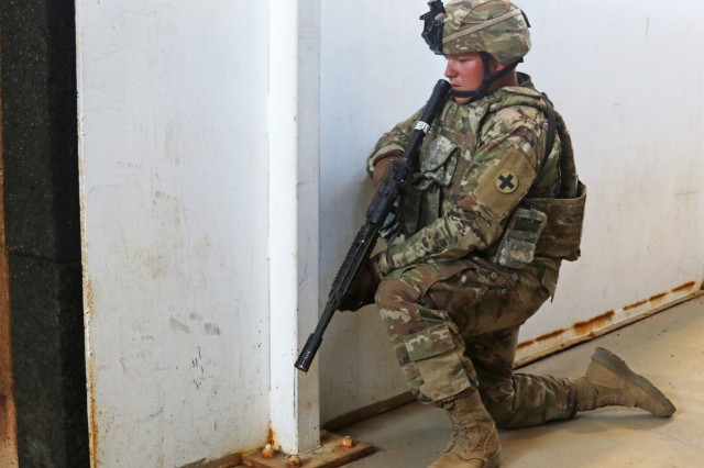 A Soldier from the 2nd Battalion, 130th Infantry Regiment, 33rd Infantry Brigade Combat Team, Illinois Army National Guard, posts guard at the entrance of a training building while the rest of his team completes room clearances during Rising Thunder 19 at the Yakima Training Center in Yakima, Washington, Sept. 1, 2019. Rising Thunder 2019 is an annual exercise joining the U.S. Army and the Japan Ground Self Defense Force (JGSDF) and is part of Pacific Pathways 19-3. Rising Thunder 2019 is also a United States Army Pacific-sponsored capstone event featuring U.S. Army units from the 7th Infantry Division and the Illinois Army National Guard's 33rd Infantry Brigade Combat Team and 108th Sustainment Brigade. The exercise includes company/platoon unilateral and bilateral training events in two phases, culminating with a bilateral live-fire exercise. (U.S. Army Reserve Photo by Sgt. Camacho Roberts)