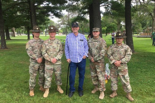Four drill sergeants (pictured) saved a family from a burning car Aug. 15, 2019, in Sparta, Wisconsin. (Pictured from right) Sgt. Roger Williams, Sgt. 1st Class Eric Juhl, David Turner (accident survivor), Sgt. 1st Class Justin McCarthy, and Sgt. Daniel McElroy, reconnect after their accident after their close call. Located in the heart of the upper Midwest, Fort McCoy is the only U.S. Army installation in Wisconsin and has provided support and facilities for the field and classroom training of more than 100,000 military personnel from all services each year since 1984.