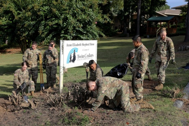 COLUMBUS, Ga. -- Officer candidates replant the plot of ground around the sign for the Anne Elizabeth Shepherd Home. More than 120 officer candidates of Class 503-19 with the U.S. Army Officer Candidate School volunteered Aug. 31 on the 15-acre grounds of the Anne Elizabeth Shepherd Home in Columbus, Georgia, the staff of which provides residential care to girls and young women ages 7 to 18 with severe emotional or behavioral disturbances. (U.S. Army photo by Markeith Horace, Maneuver Center of Excellence, Fort Benning Public Affairs)