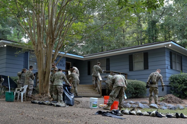COLUMBUS, Ga. -- Soldiers clean up and landscape around a cottage of the Anne Elizabeth Shepherd House. More than 120 officer candidates of Class 503-19 with the U.S. Army Officer Candidate School volunteered Aug. 31 on the 15-acre grounds of the Anne Elizabeth Shepherd Home in Columbus, Georgia, the staff of which provides residential care to girls and young women ages 7 to 18 with severe emotional or behavioral disturbances. (U.S. Army photo by Markeith Horace, Maneuver Center of Excellence, Fort Benning Public Affairs)