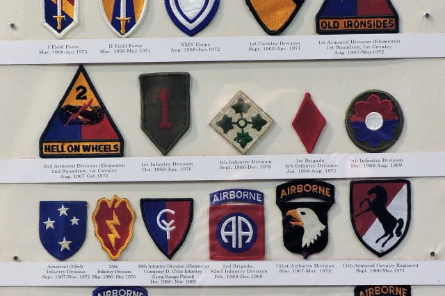 This panel of shoulder sleeve insignia, one of several in the new gallery of the Field Artillery Museum, represents major combat units that saw action in the Vietnam War era.