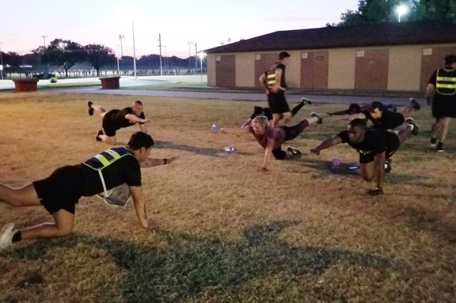 Drill sergeants from D/1-79th FA lead six congressional staffers through morning physical readiness training Aug. 20, 2019, at Fort Sill, Oklahoma. The staff members were there to learn how civilians become Soldiers.