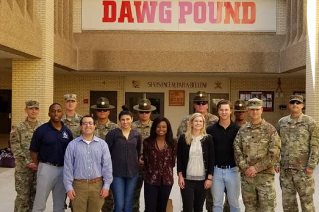 The visitors from the District of Columbia pose for a photo with leaders from 1-79th FA, at one of the Basic Combat Training barracks.