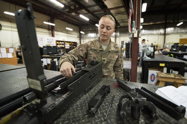 Sgt. Brittany Deturo, weapons quality assurance, 401st Army Field Support Battalion-Kuwait, checks the gap between the charging handle and the body of an M2 .50-caliber machine gun in the weapons maintenance facility of Army Prepositioned Stocks-5, Aug. 17, Camp Arifjan, Kuwait. Deturo said every inspection of a weapon at APS-5 is highly detailed, inside and out.