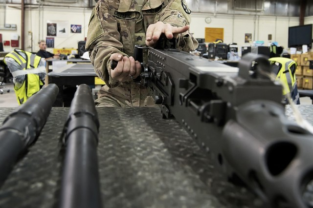 Sgt. Brittany Deturo, weapons quality assurance, 401st Army Field Support Battalion-Kuwait, checks the charging lever of an M2 .50-caliber machine gun in the weapons maintenance facility of Army Prepositioned Stocks-5, Aug. 17, Camp Arifjan, Kuwait. Deturo is a member of the 776 Support Maintenance Company of the Tennessee National Guard.
