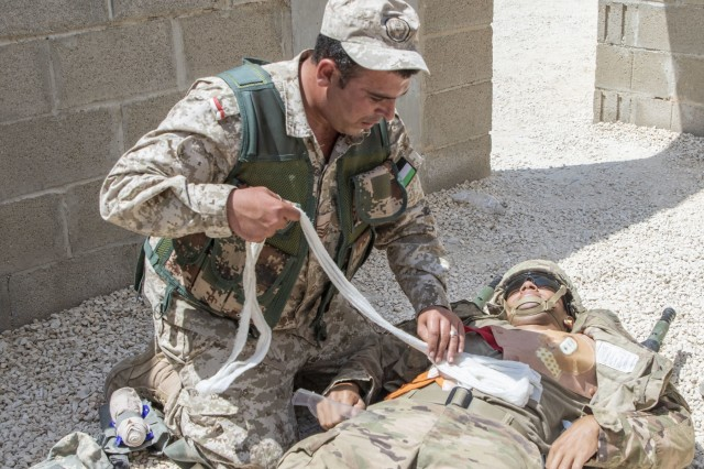A Jordan soldier, with 7th Mechanized Battalion, 48th Mechanized Brigade, treats a notional abdominal wound on a U.S. Army Soldier, with 1st Squadron, 102nd Cavalry Regiment, 44th Infantry Brigade Combat Team of the 42nd Infantry Division, New Jersey National Guard, during medical evacuation training, part of the Jordan Operational Engagement Program at Joint Training Center-Jordan August 27, 2019. The Army is optimizing for interoperability with all our allies and partners to strengthen alliances and deliver more effective coalition operations.