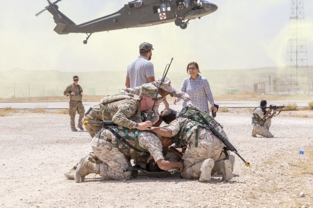Jordan soldiers, with 7th Mechanized Battalion, 48th Mechanized Brigade, cover to protect a notionally injured U.S. Army Soldier, with 1st Squadron, 102nd Cavalry Regiment, 44th Infantry Brigade Combat Team of the 42nd Infantry Division, New Jersey National Guard, as a UH-60 Black Hawk lands during medical evacuation training, part of the Jordan Operational Engagement Program at Joint Training Center-Jordan August 27, 2019. The Army is optimizing for interoperability with all our allies and partners to strengthen alliances and deliver more effective coalition operations.