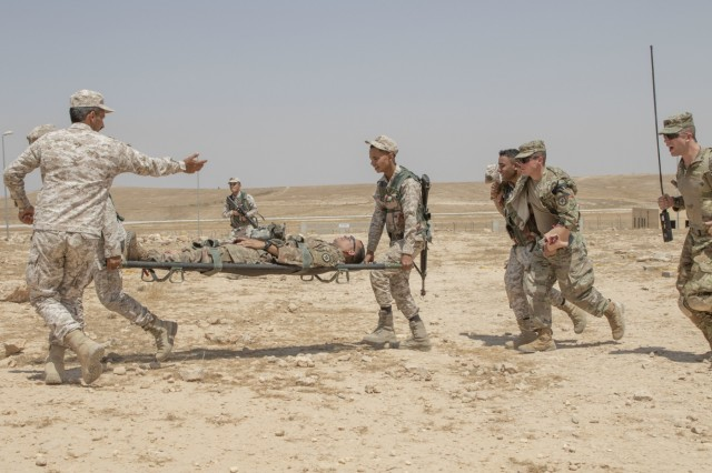 Jordan soldiers, with 7th Mechanized Battalion, 48th Mechanized Brigade, carry a U.S. Army Soldier, with 1st Squadron, 102nd Cavalry Regiment, 44th Infantry Brigade Combat Team of the 42nd Infantry Division, New Jersey National Guard, on a Litter during ground casualty evacuation training, part of the Jordan Operational Engagement Program at Joint Training Center-Jordan August 27, 2019. The Army is optimizing for interoperability with all our allies and partners to strengthen alliances and deliver more effective coalition operations.