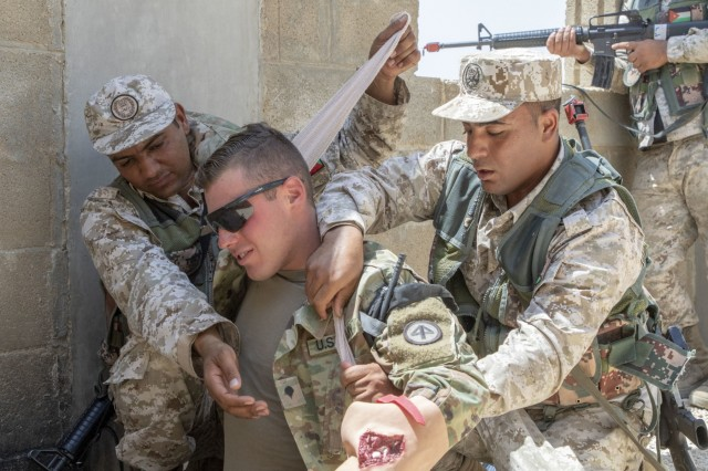 Jordan soldiers, with 7th Mechanized Battalion, 48th Mechanized Brigade, provide first aid to notional wounds on a U.S. Army Soldier, with 1st Squadron, 102nd Cavalry Regiment, 44th Infantry Brigade Combat Team of the 42nd Infantry Division, New Jersey National Guard, during medical evacuation training, part of the Jordan Operational Engagement Program at Joint Training Center-Jordan August 27, 2019. The Army is optimizing for interoperability with all our allies and partners to strengthen alliances and deliver more effective coalition operations.