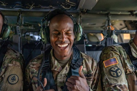 A Soldier with the Tennessee Army National Guard's 278th Armored Cavalry Regiment, celebrates his reenlistment after swearing in a UH-60 Black Hawk, 200 feet above Tullahoma, Tenn., Aug. 20, 2019.