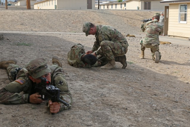 Soldiers of the 2nd Battalion, 130th Infantry Regiment, Illinois Army National Guard, participate in Combat Life Saver drills during Rising Thunder 19, September 3, 2019 at the Yakima training Center in Yakima, Washington. Rising Thunder is an annual exercise joining the U.S. Army and the Japan Ground Self Defense Force (JGSDF) with U.S. Army units from the 7th Infantry Division and the Illinois Army National Guard's 33rd Infantry Brigade Combat Team and 108th Sustainment Brigade. The exercise includes unilateral and bilateral training events, culminating with a bilateral live-fire exercise. (U.S. Army Photo by Sgt. Rigo Cisneros)