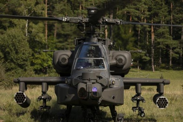 "An AH-64 Apache Attack Helicopter with the 1st Squadron, 6th Cavalry Regiment, 1st Combat Aviation Brigade, 1st Infantry Division, awaits orders during a simulated attack mission in ""the box"", as part of the culminating force-on-force exercise of Combined Resolve XII at the Joint Multinational Readiness Center in Hohenfels, Germany, Aug. 22, 2019. Combined Resolve is a biannual U.S. Army Europe and 7th Army Training Command-led exercise intended to evaluate and certify the readiness and interoperability of U.S. forces mobilized to Europe in support of Atlantic Resolve."