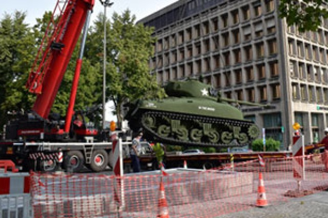 """The World War II era tank """"In The Mood"""" is offloaded in front of the Mons Memorial Museum to commemorate the 75th Anniversary of the liberation of Mons, Belgium by the 3rd Armored Division."""