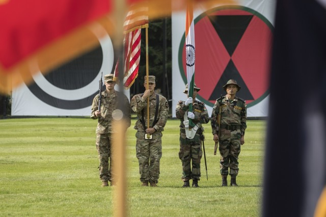 A combined color guard of 1-2 Stryker Brigade Combat Team and Indian Army soldiers present their nation's colors during the Yudh Abhyas 19 opening ceremony at Joint Base Lewis-McChord, Washington, Sept. 5, 2019. The 15th annual iteration of this bilateral training is designed toward enhancing the maturing relationship between the partnered armies as they continue to build a shared understanding during the two-week long exercise. (U.S. Army photo by Sgt. Adeline Witherspoon)