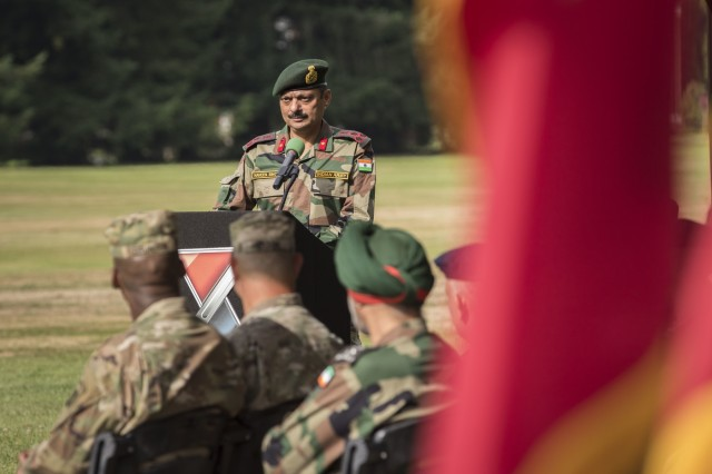 Indian Army Brigadier Naveen Singh, commander of the 8th Assam Regiment, 7th Infantry Brigade, discusses the Yudh Ahbyas 19 exercise during the opening ceremony at Joint Base Lewis-McChord, Washington, Sept. 5, 2019. The 15th annual iteration of this joint training is designed toward enhancing the maturing relationship between the U.S. and the Indian army as they continue to build a shared understanding during the two-week long exercise. (U.S. Army photo by Sgt. Adeline Witherspoon)