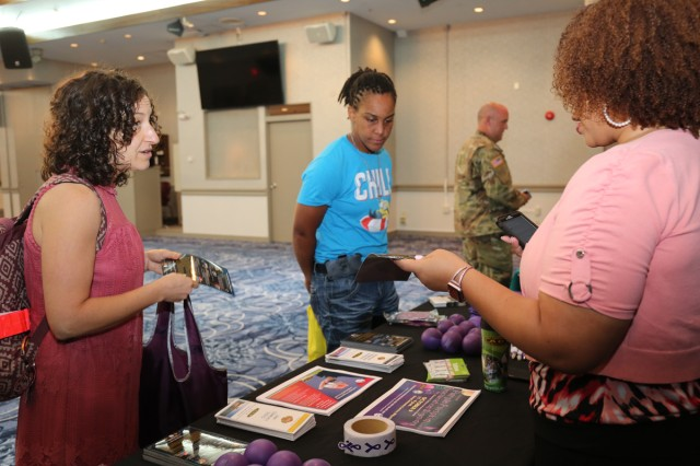 Tisha Miller, left, counselor for the Adolescent Support and Counseling Services program, or ASACS, at Zama Middle High School, talks to an Army Community Service staff member during the Resilient Living Day training event Sept. 3 at the Camp Zama Community Club. The event was held as part of Suicide Prevention Awareness Month.
