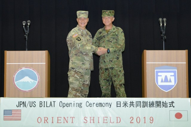 Commander of U.S. Army Japan and Commander of Western Army of the Japan Ground Self-Defense Force shake hands during opening ceremony of OS19