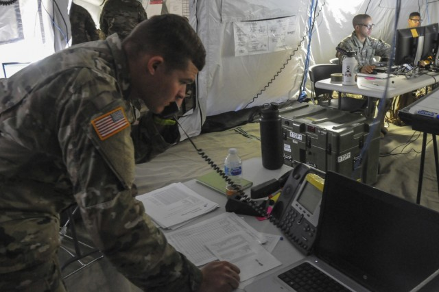 S3 Plans Officer, Cpt. John Dekoning with the 757th Combat Sustainment Support Battalion relays critical operations information to brigade during annual training at Camp Roberts, Ca. 2019.