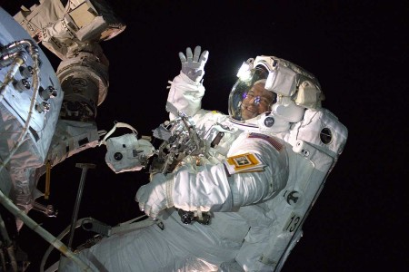 U.S. Army and NASA astronaut Andrew Morgan waves as he is photographed during an Extra Vehicular Activity, also known as a space walk, to install the International Space Station's second commercial crew vehicle docking port, the International Docking...