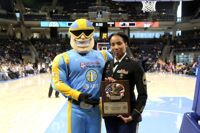 Sky Guy, left, the Women's National Basketball Association's Chicago Sky team mascot, and U.S. Army Reserve Master Sgt. Ebony Evans pause for a photo after she receives an honor for her service during the Chicago Sky's final home game, of the regular season, at the Wintrust Arena in Chicago, Illinois, September 1, 2019. Evans was honored during the game for her 19 years of service in the Army to include two deployments in support of Operation Iraqi Freedom and Operation Noble Eagle. (U.S. Army Reserve photo by Anthony L. Taylor)
