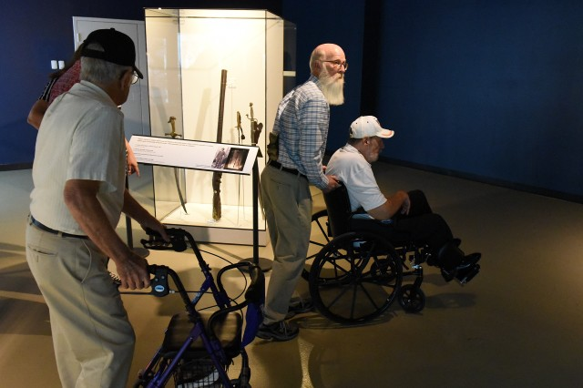 Veterans move through Patton Museum, many for the first time, learning about Gen. George Patton and his leadership style.