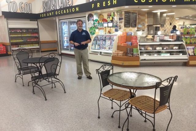 Peter Howell, returning Fort Riley Commissary officer shows the area he is working on to transform into a café area. Howell returns to Fort Riley after a few years away and is looking for ways to improve shoppers' experiences.