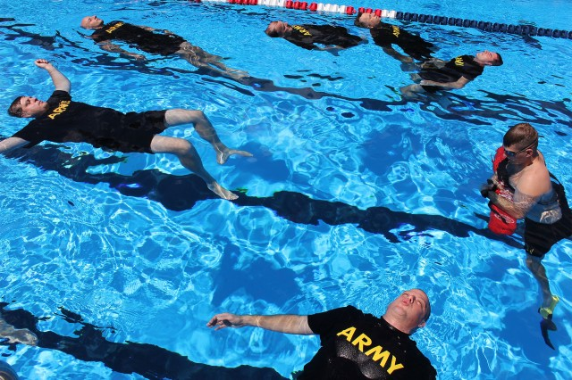 Soldiers from the 2nd Battalion, 227th Aviation Regiment, 1st Air Cavalry Brigade from Fort Hood, Texas, undergo water survival training, conducted by the U.S. Army School of Aviation Medicine, at Fort Rucker's Flynn Pool Sept. 4.