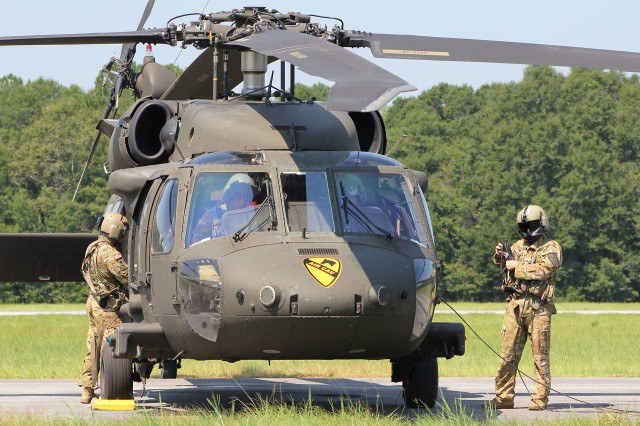 Soldiers from the 2nd Battalion, 227th Aviation Regiment, 1st Air Cavalry Brigade from Fort Hood, Texas, stand ready to depart in a UH-60 Black Hawk from Fort Rucker's Hatch Stagefield Sept. 5 for movement forward into Florida where they will stage to provide support to the Bahamas, which was battered by Hurricane Dorian recently.