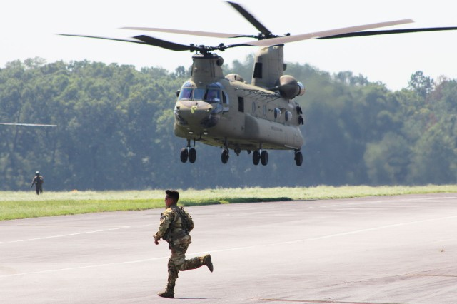 A Soldier runs across the Fort Rucker Hatch Stagefield flightline as a CH-47 Chinook from the 2nd Battalion, 227th Aviation Regiment, 1st Air Cavalry Brigade from Fort Hood, Texas, departs Sept. 5 for movement forward into Florida where they will stage to provide support to the Bahamas, which was battered by Hurricane Dorian recently.