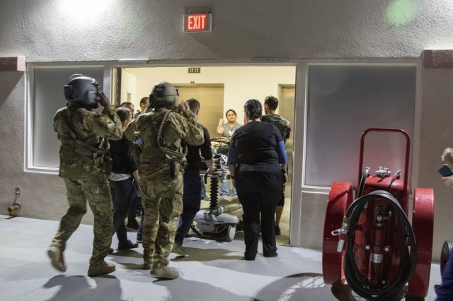Sgt. First Class Jesse Turner, left, and Staff Sgt. Matt Oneill, flight medic assigned to 2nd General Aviation Support Battalion, 4th Aviation Regiment, 4th Infantry Division accompanies University Medical Center staff during the patient transfer portion of a medical evacuation training scenario in El Paso, Texas, September 4, 2019.  Oneill said rehearsing procedures to transport injured personnel to a level 1 trauma center is vital to the preservation of life.