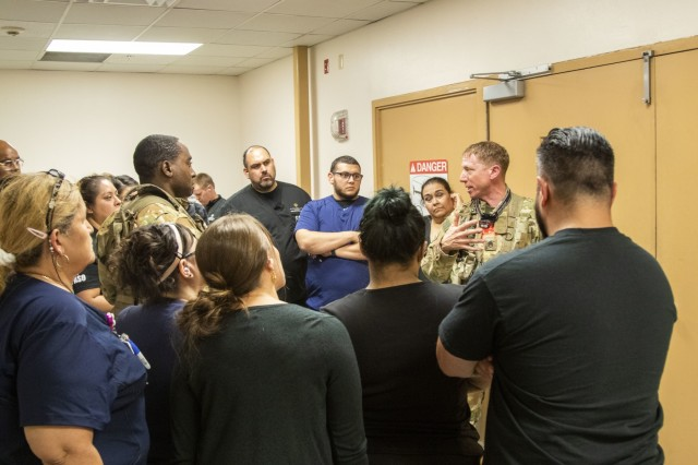 Staff Sgt. Matt Oneill, right, and Sgt. First Class Jesse Turner, flight medics assigned to 2nd General Aviation Support Battalion, 4th Aviation Regiment, 4th Infantry Division discuss safety procedures with emergency department staff for receiving patients from an operating UH-60 Black Hawk at University Medical Center, El Paso, Texas, September 4, 2019.  Patient transfers to UMC, the city's level 1 trauma center, happen to ensure critically injured patients receive the highest level of medical care.
