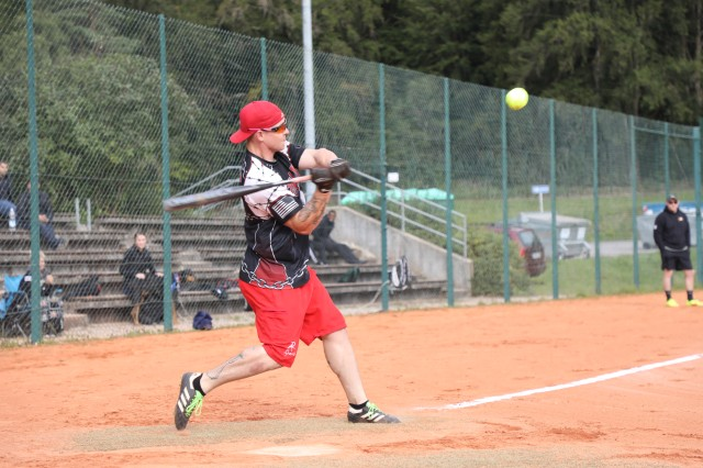A U.S. Soldier with Joint Multinational Readiness Center hits a softball during Organization day at Hohenfels, Germany, Sep. 6, 2019. (U.S. Army photo by Spc Enrique Moya)