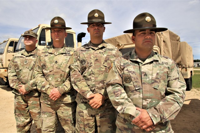 (From left) Sgt. 1st Class Justin McCarthy with the 108th Training Command at Charlotte, N.C.; Sgt. 1st Class Eric Juhl with Bravo Company, 3rd Battalion, 415th Infantry Regiment of Helena, Mont.; Sgt. Roger Williams with Charlie Company, 3rd Battalion, 1st Brigade, 334th Regiment, 95th Training Division in Milwaukee; and Sgt. Daniel McElroy with 3rd Battalion, 1st Brigade, 320th Regiment, 95th Training Division at Fort Belvoir, Va., are shown Aug. 21, 2019, at Fort McCoy, Wis. These four Soldiers, along with Master Sgt. Ryan Cameron with U.S. Army Reserve Command (USARC) Headquarters of Fort Bragg, N.C., helped rescue a man and two children from a car accident Aug. 15, 2019, in Sparta, Wis.
