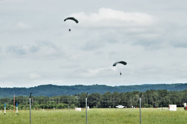 Special operations Airmen with the 123rd Special Tactics Squadron of the Kentucky Air National Guard at Louisville conduct an airborne insertion jump at Sparta-Fort McCoy Airport on July 16, 2019, after parachuting from a C-130H Hercules for a Patriot North 2019 exercise scenario at Fort McCoy, Wis. The National Guard Bureau exercise is designed for civilian emergency management and responders to work with military entities in the same manner they would during disasters. Patriot North provided Soldiers and Airmen with a chance to improve their skills to respond to a natural disaster and work with emergency management agencies. More than 700 civilians, volunteers, and National Guard Soldiers and Airmen from more than 20 states supported the 2019 exercise at Volk Field, Wis., and Fort McCoy. (U.S. Army Photo by Scott T. Sturkol, Public Affairs Office, Fort McCoy, Wis.)