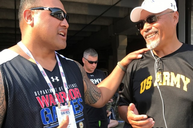 Retired Sgt. 1st Class David Iuli gets a bit of last minute advice from his father-in -law retired Command Sgt. Major Tuli Malauulu before the shot put and discus competition during the 2017 Warrior Games in Chicago. The games is an adaptive sports competition for wounded, ill and injured service members and veterans. Approximately 265 athletes representing teams from the Army, Marine Corps, Navy, Air Force, Special Operations Command, United Kingdom Armed Forces, and the Australian Defence Force will compete June 30 - July 8 in archery, cycling, track, field, shooting, sitting volleyball, swimming, and wheelchair basketball. (U.S. Army photo by Annette P. Gomes)
