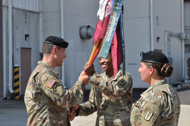 Lt. Col. Marc R. Welde, left, commander of U.S. Army Medical Materiel Center-Korea, passes a flag on Aug. 9 to Maj. Chewanda E. Jones, who takes command of the 95th Medical Detachment (Blood Support). Also pictured is Sgt. 1st Class Marina Prewitt.