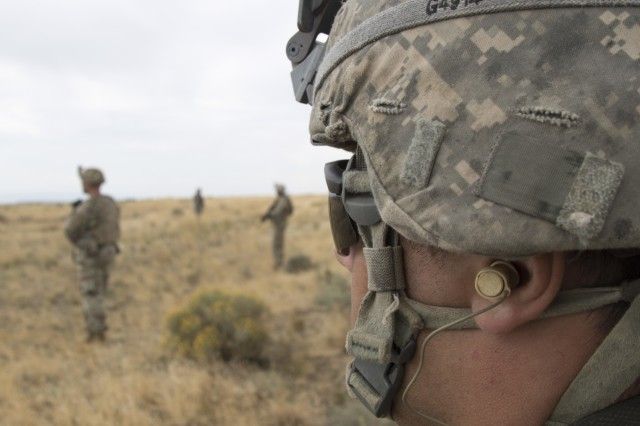 YAKIMA, Wash. - An American Soldier looks out over a field during Rising Thunder 19. Rising Thunder 2019 is an annual exercise between the U.S. Army and the Japan Ground Self-Defense Force featuring units from the 7th Infantry Division, the Illinois Army National Guard's 33rd Infantry Brigade Combat Team and 108th Sustainment Brigade, and Japan's 25th Infantry Regiment. The exercise, held Aug. 28 - Sept. 13 at Yakima Training Center in Yakima, Washington, consists of company/platoon unilateral and bilateral training events in two phases, culminating with a bilateral live fire exercise. (U.S. Army Reserve photo by Sgt. Jeff Daniel)