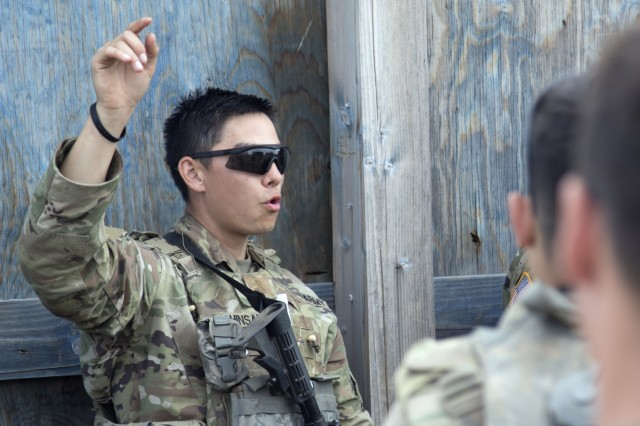 YAKIMA, Wash. - 2nd Lt. Andrew Shinsako, platoon leader for Alpha Company, 1st Platoon, 1st Battalion, 178th Infantry Regiment provides feedback to his troops after a blank fire interation during Rising Thunder 19. Rising Thunder 2019 is an annual exercise between the U.S. Army and the Japan Ground Self-Defense Force featuring units from the 7th Infantry Division, the Illinois Army National Guard's 33rd Infantry Brigade Combat Team and 108th Sustainment Brigade, and Japan's 25th Infantry Regiment. The exercise, held Aug. 28 - Sept. 13 at Yakima Training Center in Yakima, Washington, consists of company/platoon unilateral and bilateral training events in two phases, culminating with a bilateral live fire exercise. (U.S. Army Reserve photo by Sgt. Jeff Daniel)