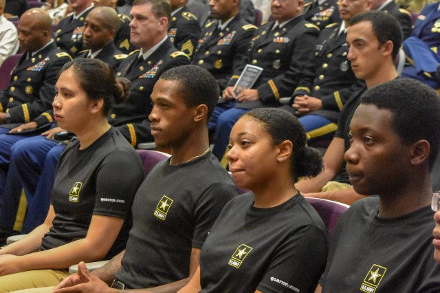 "Elwin Carter, second from the left, listens to  Lt. Gen. Bruce T. Crawford, Army chief information officer and G-6, speak during a ""Why We Serve"" ceremony at Fort Belvoir, Va., Sept. 5, 2019. Carter joined 30 young men and women from the Baltimore and Richmond areas as they all raised their right hand to take the Oath of Enlistment."
