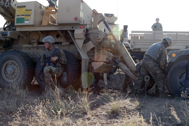 Sgt. Brett Montgomery from the 1844th Transportation Company, 108th Sustainment Brigade, pulls security while the maintenance crew hooks up a downed humvee to their recovery vehicle. Rising Thunder 2019 is an annual exercise joining the U.S. Army and the Japanese Ground Self-Defense Force (JGSDF) and is part of Pacific Pathways 19-3. Rising Thunder 2019 is also a United States Army Pacific-sponsored capstone event featuring U.S. Army units from the 7th Infantry Division and the Illinois Army National Guard's 33rd Infantry Brigade Combat Team and 108th Sustainment Brigade. (Illinois Army National Guard photo by Spc. Shaylin Quaid)