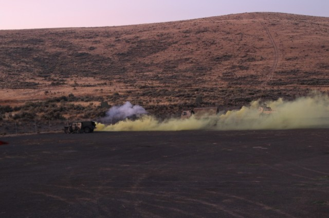 Soldiers from the 1844th Transportation Company, 108th Sustainment Brigade, and medics from the 33rd Infantry Brigade Combat Team, both part of the Illinois Army National Guard, are faced with a chemical attack and small arms fire during their morning base defense. Rising Thunder 2019 is an annual exercise joining the U.S. Army and the Japanese Ground Self-Defense Force (JGSDF) and is part of Pacific Pathways 19-3. Rising Thunder 2019 is also a United States Army Pacific-sponsored capstone event featuring U.S. Army units from the 7th Infantry Division and the Illinois Army National Guard's 33rd Infantry Brigade Combat Team and 108th Sustainment Brigade. (Illinois Army National Guard photo by Spc. Shaylin Quaid)