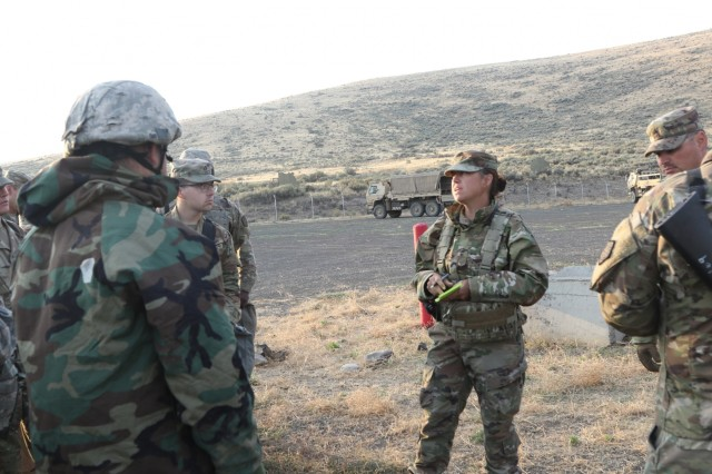 1st Lt. Jamie Gunning from the 1844th Transportation Company, 108th Sustainment Brigade, conducts an after action review following the chemical attack during morning base defense. Rising Thunder 2019 is an annual exercise joining the U.S. Army and the Japanese Ground Self-Defense Force (JGSDF) and is part of Pacific Pathways 19-3. Rising Thunder 2019 is also a United States Army Pacific-sponsored capstone event featuring U.S. Army units from the 7th Infantry Division and the Illinois Army National Guard's 33rd Infantry Brigade Combat Team and 108th Sustainment Brigade. (Illinois Army National Guard photo by Spc. Shaylin Quaid)