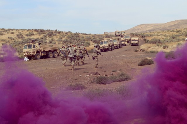 Soldiers from the 1844th Transportation Company, 108th Sustainment Brigade, and medics from the 33rd Infantry Brigade Combat Team, both part of the Illinois Army National Guard, engage their culminating exercise at Rising Thunder 19 at Yakima Training Center in Yakima, Wash., Sept. 6, 2019. The Guardsmen have been training for this phase of the event for more than a week with various troop transport lanes, improvised explosive lanes, and land navigation lanes. Rising Thunder 2019 is an annual exercise joining the U.S. Army and the Japanese Ground Self-Defense Force (JGSDF) and is part of Pacific Pathways 19-3. Rising Thunder 2019 is also a United States Army Pacific-sponsored capstone event featuring U.S. Army units from the 7th Infantry Division and the Illinois Army National Guard's 33rd Infantry Brigade Combat Team and 108th Sustainment Brigade. (Illinois Army National Guard photo by Spc. Shaylin Quaid)